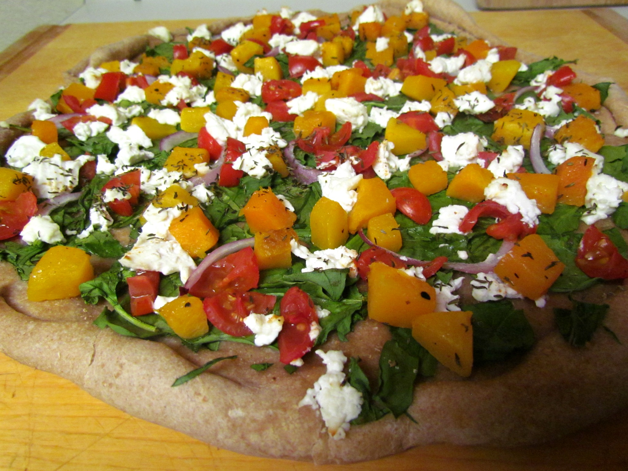 Butternut Squash, Spinach, Goat Cheese & Tomato Pizza