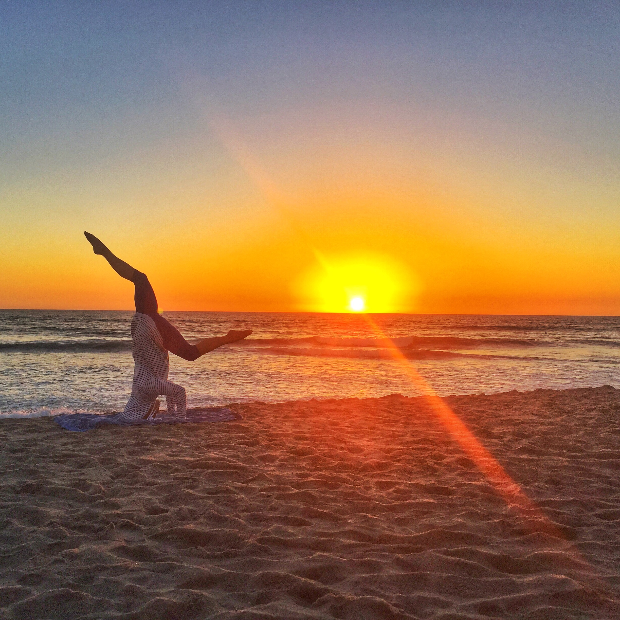 headstand play at sunset
