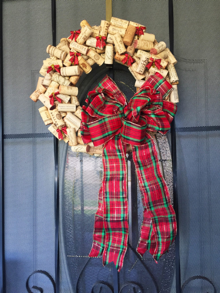 My best DIY project to date is back! This wine cork Christmas wreath is my favorite outdoor decoration.
